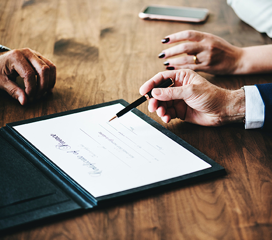 stock photo of hands signing document